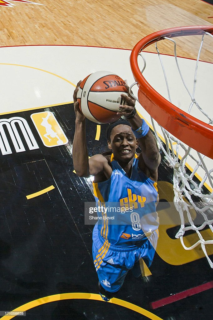 <a gi-track='captionPersonalityLinkClicked' href=/galleries/search?phrase=Swin+Cash&family=editorial&specificpeople=202486 ng-click='$event.stopPropagation()'>Swin Cash</a> #8 of the Chicago Sky grabs a rebound against the Tulsa Shock during the WNBA game on June 20, 2013 at the BOK Center in Tulsa, Oklahoma.