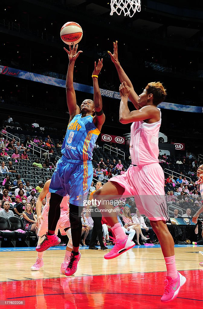 Swin Cash #8 of the Chicago Sky puts up a shot against Angel McCoughtry #35 of the Atlanta Dream at Philips Arena on August 24 2013 in Atlanta, Georgia.