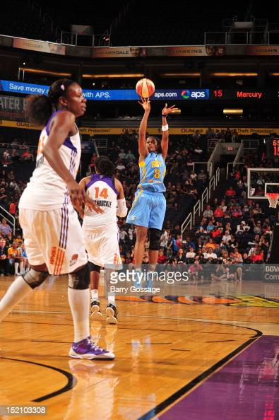 Swin Cash of the Chicago Sky shoots against Alexis Hornbuckle of the Phoenix Mercury on September 16 2012 at US Airways Center in Phoenix Arizona...