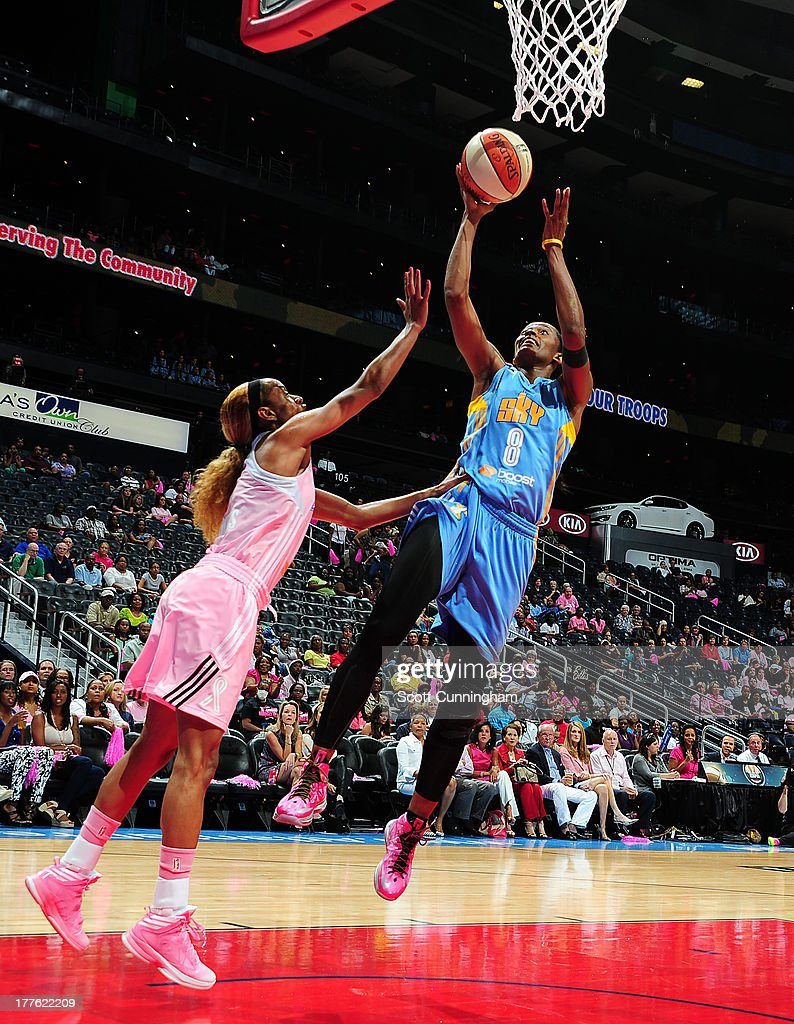 <a gi-track='captionPersonalityLinkClicked' href=/galleries/search?phrase=Swin+Cash&family=editorial&specificpeople=202486 ng-click='$event.stopPropagation()'>Swin Cash</a> #8 of the Chicago Sky shoots against the Atlanta Dream at Philips Arena on August 24 2013 in Atlanta, Georgia.