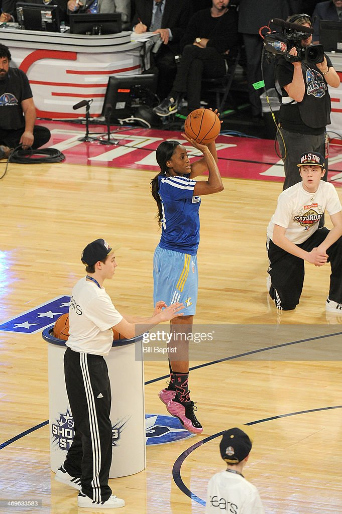 <a gi-track='captionPersonalityLinkClicked' href=/galleries/search?phrase=Swin+Cash&family=editorial&specificpeople=202486 ng-click='$event.stopPropagation()'>Swin Cash</a> #8 of the East Team shoots during the Sears Shooting Stars Competition on State Farm All-Star Saturday Night as part of the 2014 All-Star Weekend at Smoothie King Center on February 15, 2014 in New Orleans, Louisiana.