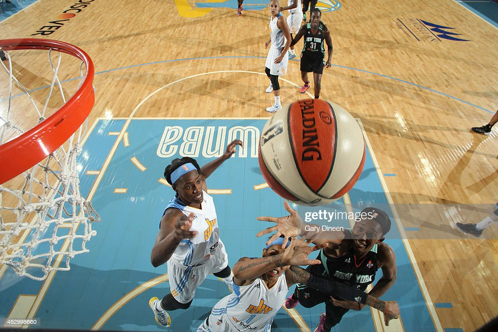 <a gi-track='captionPersonalityLinkClicked' href=/galleries/search?phrase=Swin+Cash&family=editorial&specificpeople=202486 ng-click='$event.stopPropagation()'>Swin Cash</a> #32 of the New York Liberty battles for a rebound with Sylvia Fowles #34 and Tamera Young #1 of the Chicago Sky during the game on July 31, 2014 at Allstate Arena in Rosemont, Illinois.