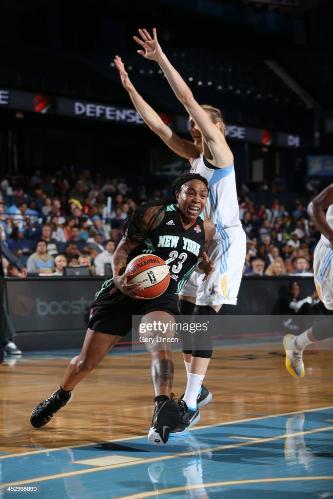 <a gi-track='captionPersonalityLinkClicked' href=/galleries/search?phrase=Swin+Cash&family=editorial&specificpeople=202486 ng-click='$event.stopPropagation()'>Swin Cash</a> #23 of the New York Liberty drives past Allie Quigley #14 of the Chicago Sky during the game on July 31, 2014 at Allstate Arena in Rosemont, Illinois.