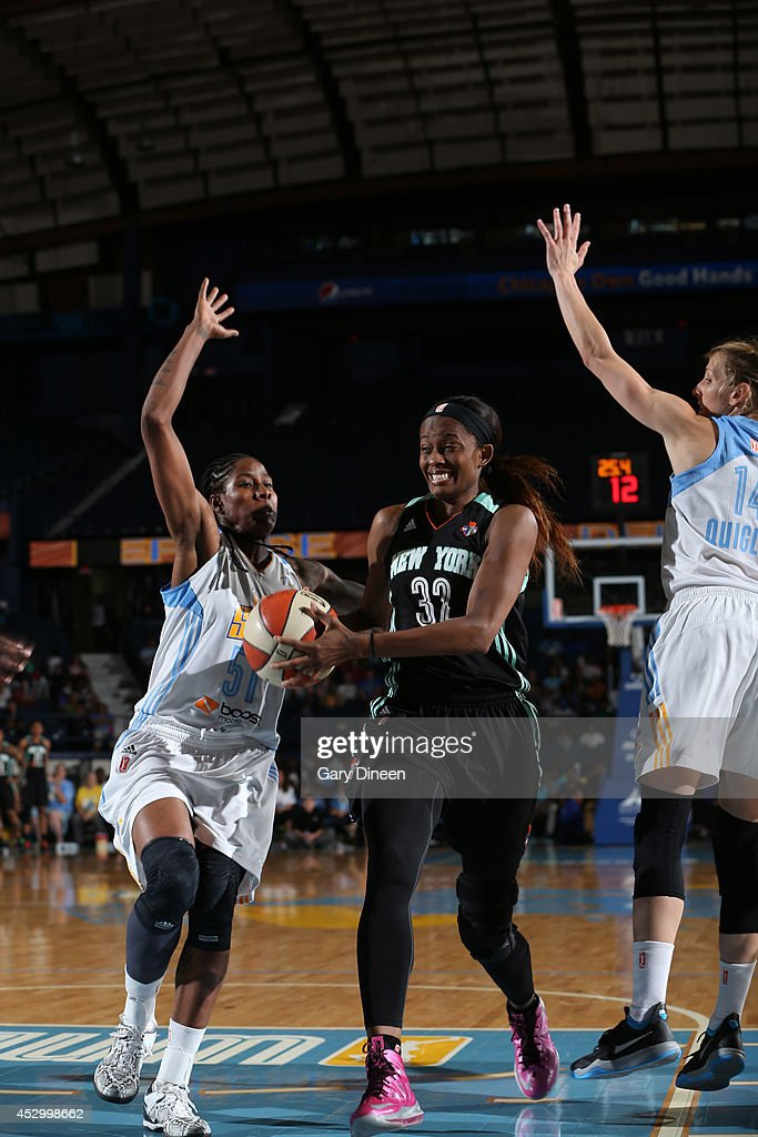 <a gi-track='captionPersonalityLinkClicked' href=/galleries/search?phrase=Swin+Cash&family=editorial&specificpeople=202486 ng-click='$event.stopPropagation()'>Swin Cash</a> #32 of the New York Liberty drives past Jessica Breland #51 and Allie Quigley #14 of the Chicago Sky during the game on July 31, 2014 at Allstate Arena in Rosemont, Illinois.
