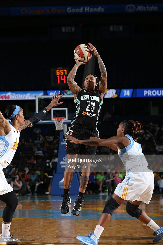 <a gi-track='captionPersonalityLinkClicked' href=/galleries/search?phrase=Swin+Cash&family=editorial&specificpeople=202486 ng-click='$event.stopPropagation()'>Swin Cash</a> #23 of the New York Liberty shoots over Tamera Young #1 and Jamierra Faulkner #21 of the Chicago Sky during the game on July 31, 2014 at Allstate Arena in Rosemont, Illinois.