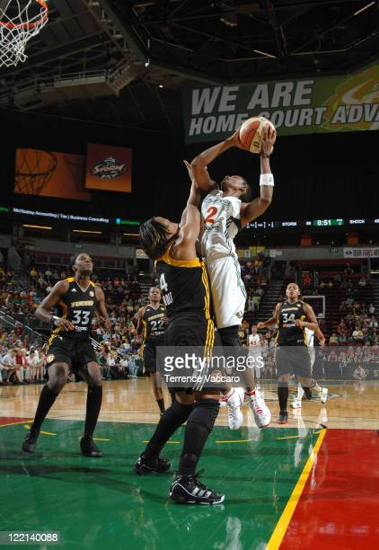 Swin Cash of the Seattle Storm goes to the basket against Amber Holt of the Tulsa Shock during the game on August 25 2011 at Key Arena in Seattle...