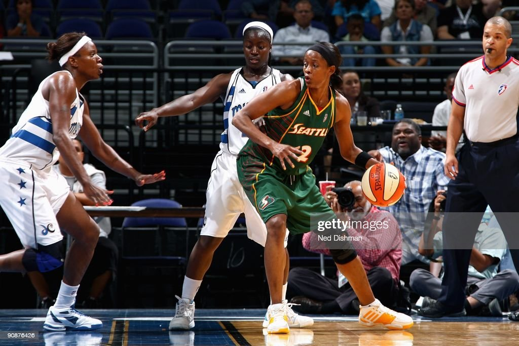 Swin Cash of the Seattle Storm goes up against Nakia Sanford and Matee Ajavon of the Washington Mystics during the WNBA game on September 3 2009 at...
