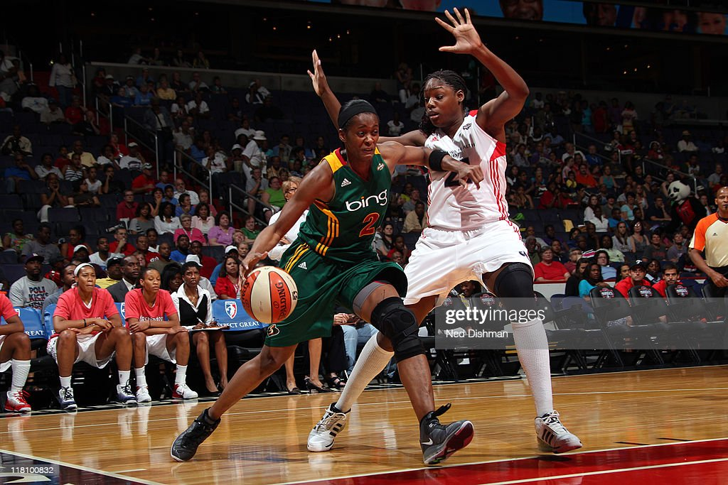 Swin Cash of the Washington Mystics drives against Nicky Anosike of the Seattle Storm at the Verizon Center on July 3 2011 in Washington DC NOTE TO...