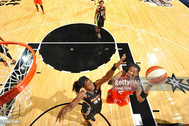 Swin Cash of the Western Conference AllStars shoots against Tina Charles of the Eastern Conference AllStars during the 2011 WNBA AllStar Game at ATT...