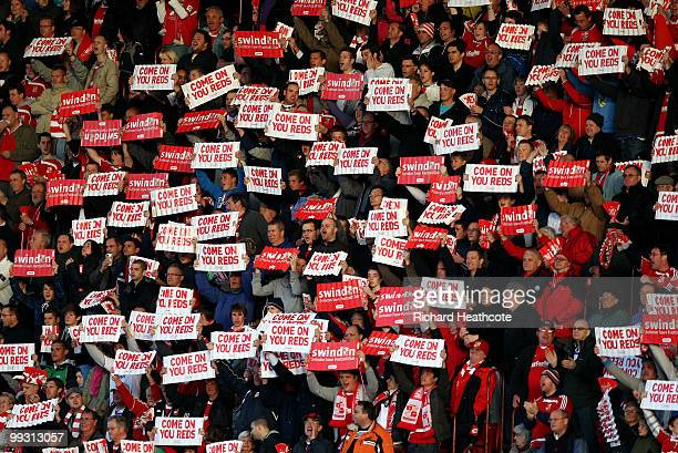 Swindon fans show their support during the CocaCola League One Playoff Semi Final 1st leg match between Swindon Town and Charlton Athletic at The...