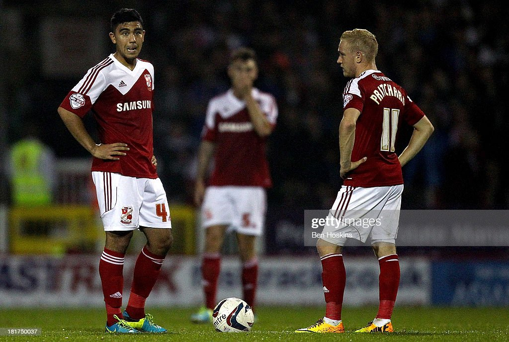 Swindon players looks dejected after conceding their second goal of the game during the Capital One Cup third round match between Swindon Town and Chelsea at County Ground on September 24, 2013 in Swindon, England.