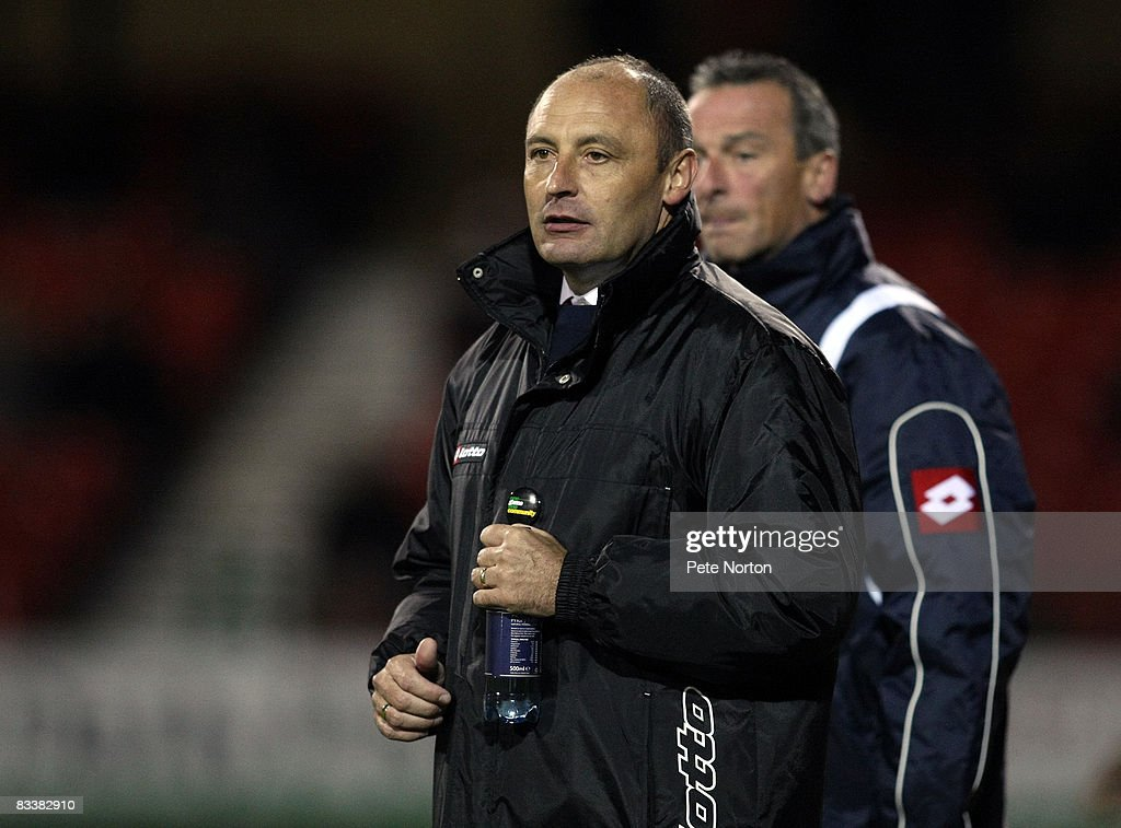 Swindon Town manager Maurice Malpas looks on during the Coca Cola League One Match between Swindon Town and Northampton Town at the County Ground on October 21, 2008 in Swindon, England.
