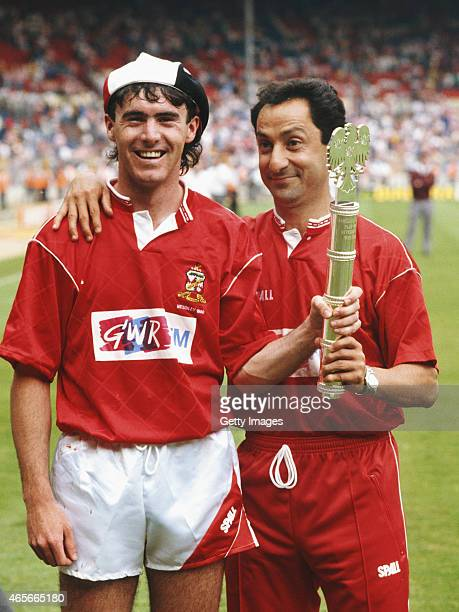 Swindon Town manager Osvaldo Ardiles and player Alan McLoughlin pose with the Division Two play off winners trophy after the League Division Two Play...