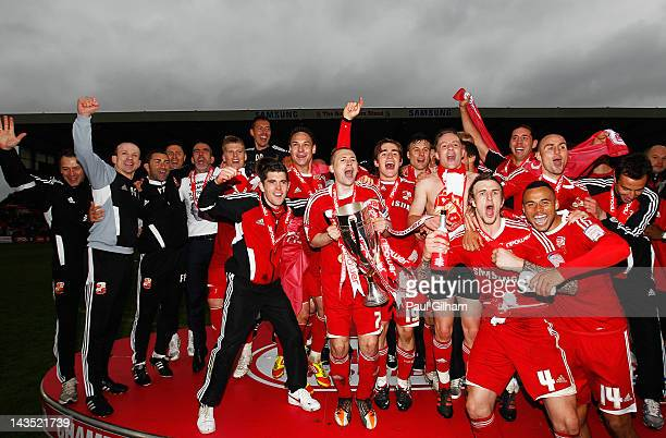 Swindon Town players celebrate being crowned champions at the end of the npower League Two match between Swindon Town and Port Vale at the County...