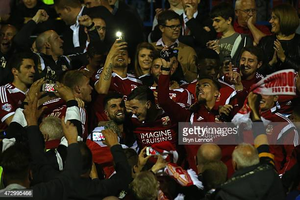 Swindon Town players celebrate in the stands after winning the Sky Bet League 1 Playoff SemiFinal between Swindon Town and Sheffiled United at County...