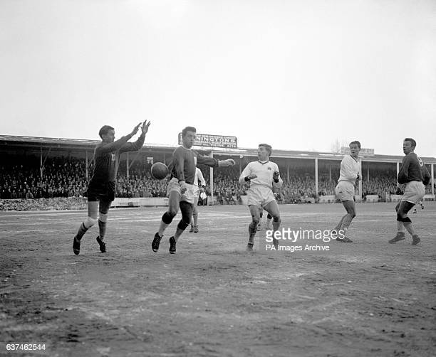 Swindon Town's Ernie Hunt beats Crystal Palace goalkeeper Bill Glazier to the ball watched by teammate Jack Smith and Palace's Albert Howe