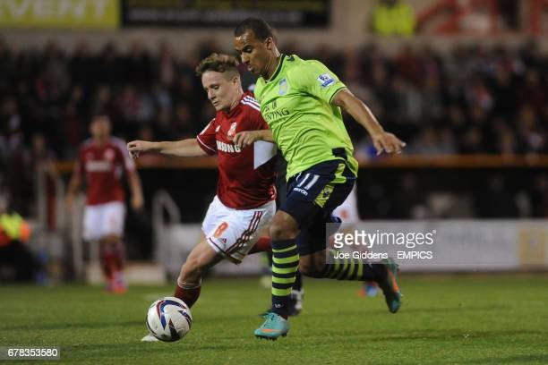 Swindon Town's Simon Ferry and Aston Villa's Gabriel Agbonlahor battle for the ball