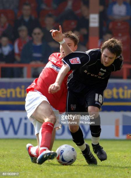 Swindon's Chris McPhee tussles with Brentford's Sam Tillen during the League One match at The County Ground Swindon