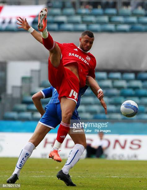 Swindon's John Bostock is challenged by Gillingham's Lewis Montrose during the League Two match at the MEMS Priestfield Stadium Gillingham