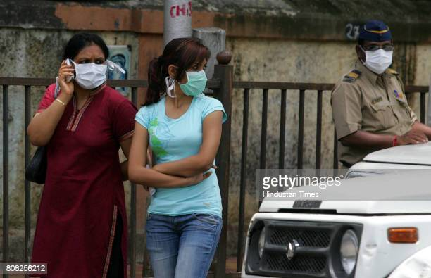 Swine Flu in Mumbai Passerby women outside Kasturba hospital cover their faces to protect themselves from swine flu on Sunday