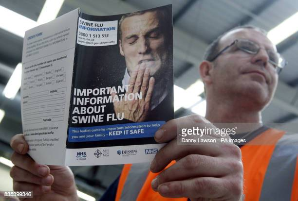 Swine flu leaflets that are due to go to every house in the UK that arrived in Edinburgh today are checked unloaded and sorted by staff at the Royal...
