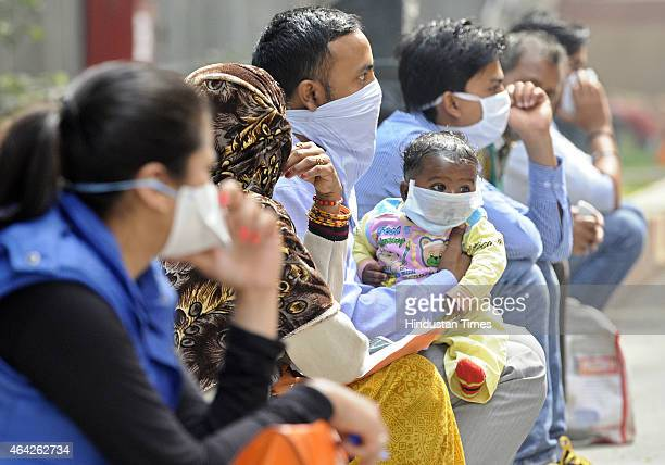 Swine flu suspect patients waiting for their turn outside the swine flu screening ward at the Ram Manohar Lohia on February 23 2015 in New Delhi...