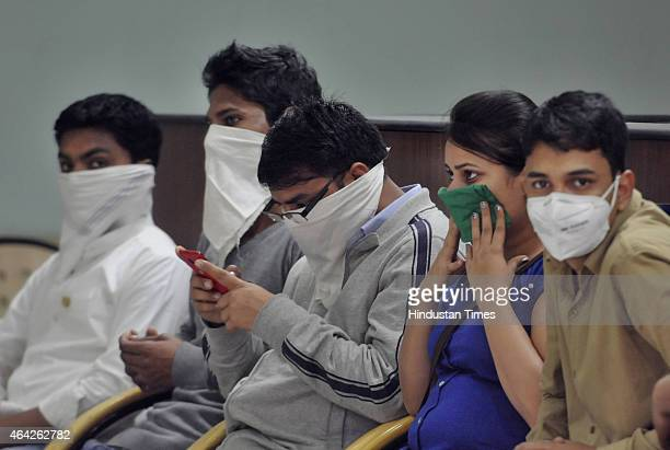 Swine flu suspect patients waiting outside the outside swine flu screening centre at the Ram Manohar Lohia on February 23 2015 in New Delhi India...