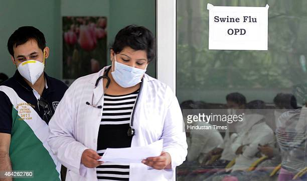Swine flu suspect patients waiting outside the swine flu screening centre at the Ram Manohar Lohia on February 23 2015 in New Delhi India According...