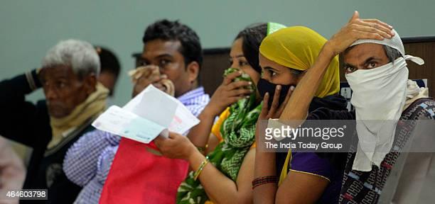 Swine flu suspect patients waiting outside the swine flu screening centre at the Ram Manohar Lohia hospital in New Delhi