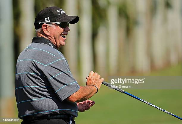Swing coach Butch Harmon laughs on the range during a practice round ahead of the Cadillac Championship at Trump National Doral on March 2 2016 in...