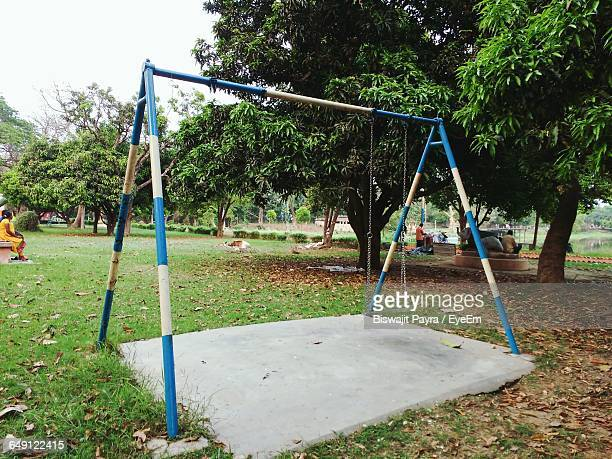 Swing In Playground At Park