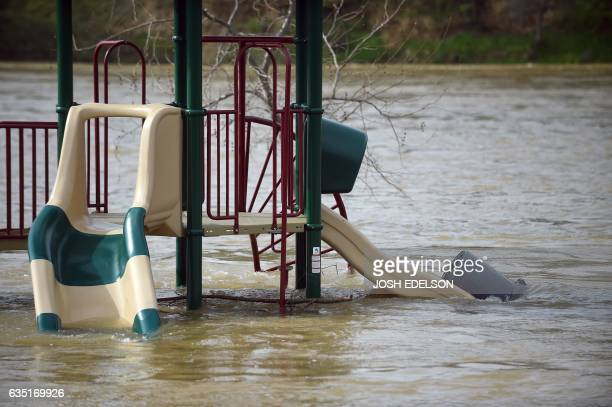 A swing is seen partially submerged in flowing water at Riverbend Park in Oroville California on February 13 2017 Almost 200000 people were under...