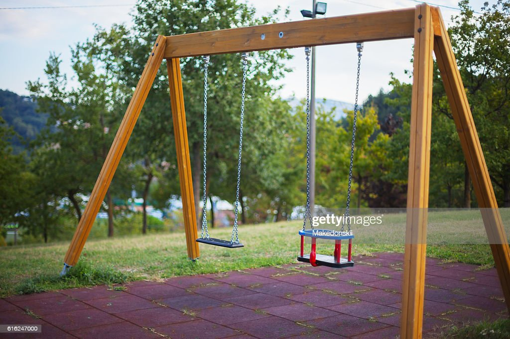 Swing on the playground. : Stock Photo