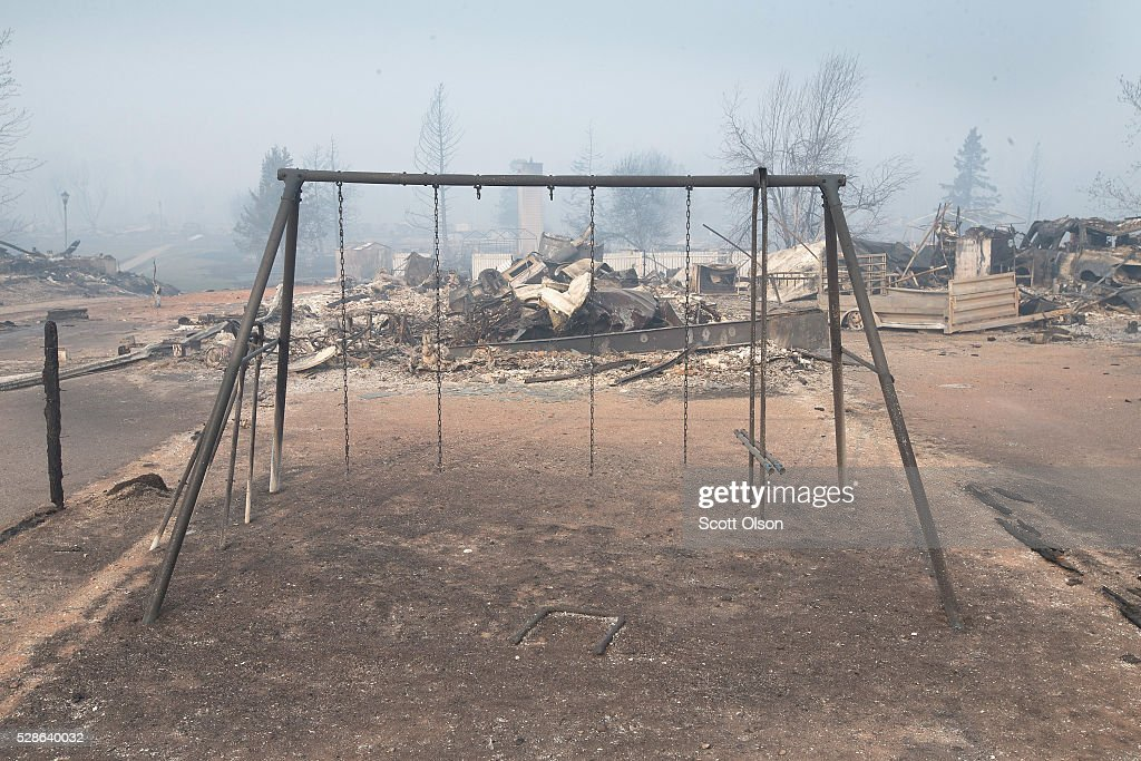 A swing set with the swings burned away sits in a residential neighborhood destroyed by a wildfire on May 6, 2016 in Fort McMurray, Alberta, Canada Wildfires, which are still burning out of control, have forced the evacuation of more than 80,000 residents from the town.