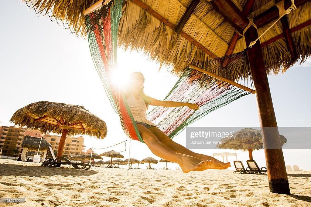 swinging in a hammock.
