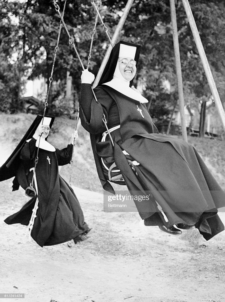 Swinging into some fun before school begins and they start teaching again are Sisters Liloise and Pelagia, instructors at Immaculate Heart Elementary School in Cleveland. Some 200 sisters of St. Joseph, representing 15 parochial schools, tossed their dignity to the wind and enjoyed a day of merrymaking on an annual picnic at a local amusement park.