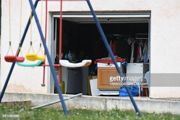 Swings are seen in front of the garage of the villa where was arrested a 72yearold man suspected of being among the armed men who took part in the...