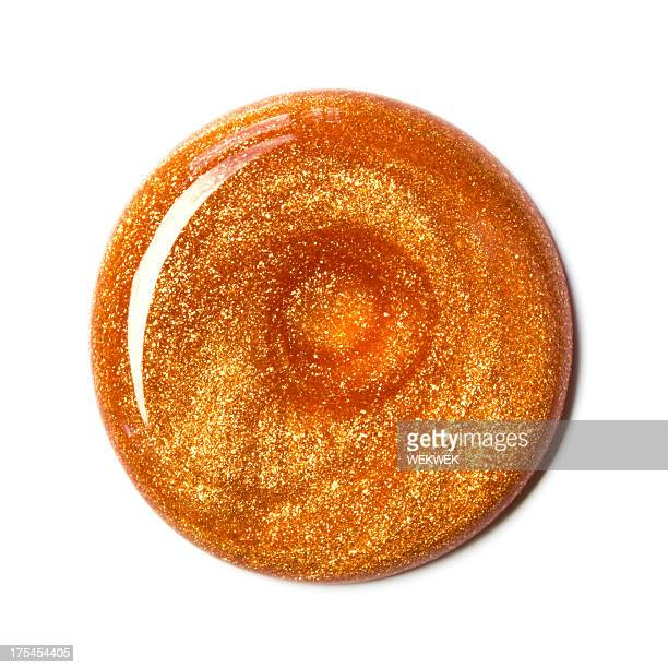 Swirl of orange nail polish, overhead view