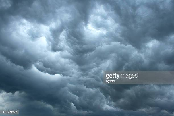 Swirling, threatening gray storm clouds filling sky