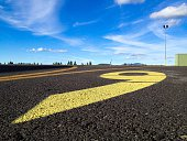 Swirls And Curve Lines On Taxiway With Sky In Background
