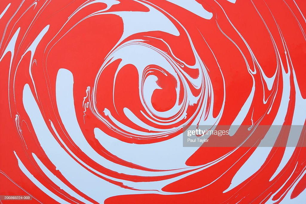 Swirls of blue and red paints : Stock Photo