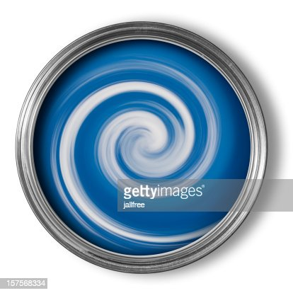 Swirls of mixing paint in open paint tin on white