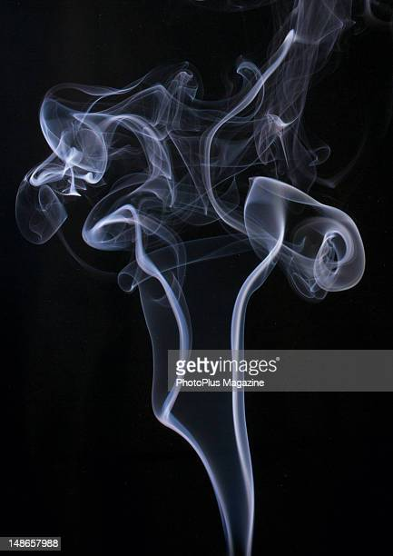 Swirls of white smoke against a black background taken on November 4 2011