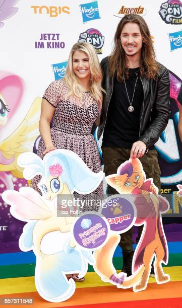 Swis singer Beatrice Egli and German singer Gil Ofarim attend the 'My little Pony' Premiere at Zoo Palast on October 3 2017 in Berlin Germany