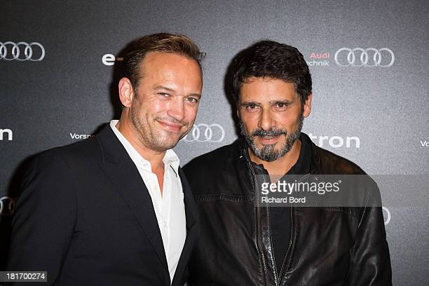 Swiss actor Vincent Perez and french actor and director Pascal Elbe attend the 'Audi etron' party at Portes de Versailles on September 23 2013 in...
