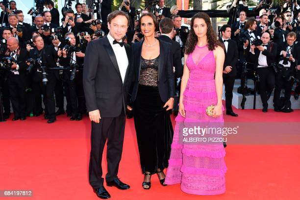 Swiss actor Vincent Perez and his wife French screenwriter Karine Silla pose with their daughter Iman as they arrive on May 17 2017 for the screening...