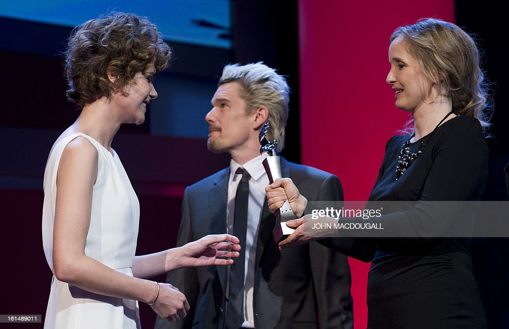 Swiss actress Carla Juri (L) receives her Shooting Star award from French actress Julie Delpy during the 63rd Berlinale Film Festival in Berlin February 11, 2013. The Shooting Star awards reward Europe's best young promising actors.