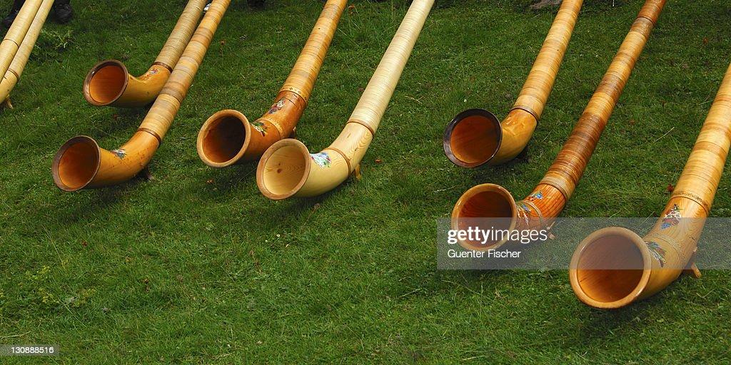Swiss Alphorns at a Swiss folk festival, Valais, Switzerland, Europe