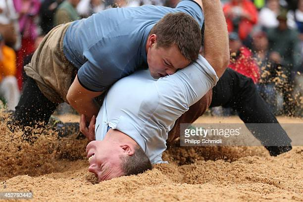 Swiss Alpine wrestler Alex Schuler fights on top of Matthias Sempach during the Alpine Wrestling Festival BruenigSchwinget at the top of the Bruenig...