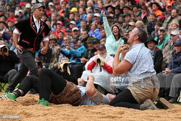Swiss Alpine wrestler Arnold Forrer jubilates after winning against Matthias Sempach during the Alpine Wrestling Festival BruenigSchwinget at the top...